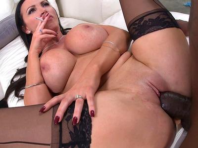 Badass nymphomaniac Nikki Benz blowing smoke as she takes black cock