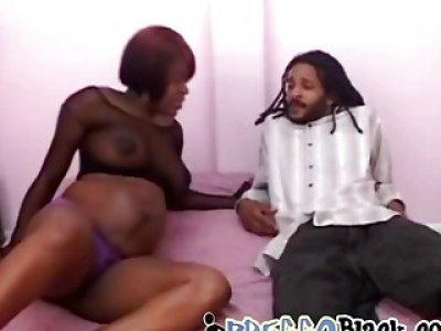 Pregnant black amateur riding big black cock on the bed