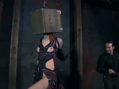 Tight ginger girl Damon Pierce gets her head locked in the wooden box