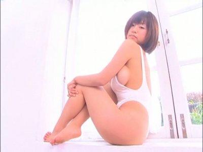 Mouth-watering Japanese babe Hitomi Kitamura poses on cam wearing seductive white swim suit