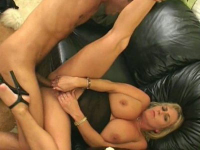 Bootylicious blonde mom riding a young guy on the couch