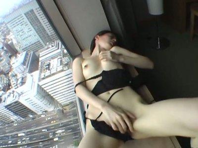 Skinny pale skin whore Ai Himeno masturbating by the window