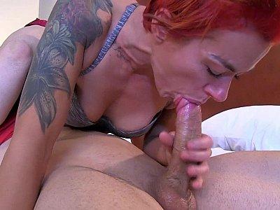 Redheaded MILF deepthroats a dick