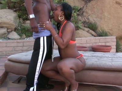Ebony whore Unique LaSage gives blowjob outdoors