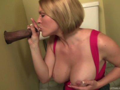 Busty milf Krissy Lynn blows dick of Sledge Hammer in the restroom