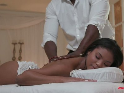 Mandingo fucks beautiful black client Nia Nacci on the massage table